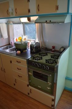 I sure would find a way to replace that 1970's avocado green range.