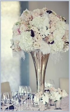 Wedding Centerpieces like the silver vase would look great with red roses!