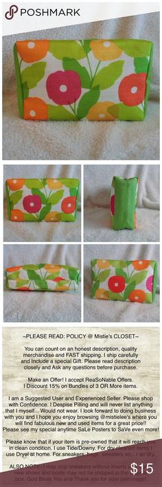 """FREE w/$35 Cosmetic Purchase Made by: Clinique Poppy Flower Designed Cosmetic Bag. Color: Green, Yellow, Magenta, Orange on White. Measurements: 5.5""""TallX 8""""WideX 2.5""""Thick. Canvas type material Zipper closure. Logo sported on the pull. This bag has been stored. Never used. Excellent condition. Please see my other items and bundle to save more. You can receive this bag for Free when you purchase $35 in Cosmetics. Thank you for browsing my closet. Clinique Bags Cosmetic Bags & Cases"""