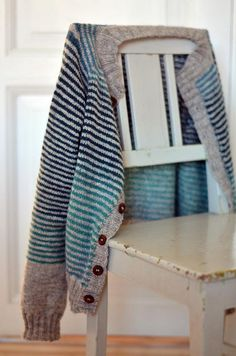 Finished jacket by osloann. I love the grey and blue stripes, and the changing blue yarn...... ( me too! )