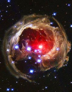 Light Echo via the Hubble Space Telescope. The red star at the centre of the eyeball-like feature is an unusual erupting supergiant called V838 Monocerotis, located about 20,000 light-years away in the winter constellation Monoceros (the Unicorn).