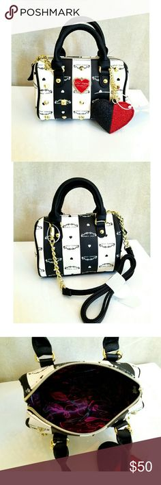 """NWT Betsy Johnson mini barrel purse New ivory, black and red mini barrel handbag with golf studs and puffy heart keychain. Approximately 7.25"""" x 5.25"""" x 2.25"""" Has removeable cross body strap with approx 23"""" drop. Hand handle dropb about 3.5"""".  This is new though I accidently knocked the tag of and just tied it back on. NO TRADES! Betsey Johnson Bags Mini Bags"""