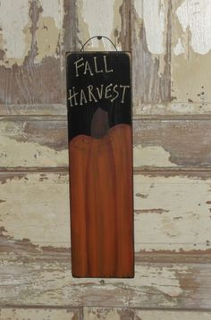 I have painted this sign with a black background, painted a prim pumpkin and added Fall Harvest at the top. I have distressed the edges for more of a primitive look.   Nice accent for your fall décor.    Measures 5.5 x 19.5 long