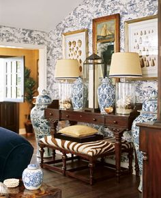 Classic chinoiserie mixes with animal print in this bold living room - Traditional Home®  Lamps with shells / blue Chinese vases