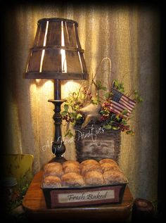 Did you know the old all wood 5/8 bushel baskets makes for a very unique lamp shade?  Pretty nifty!  by At Home Primitives