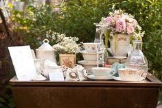 Regency era inspired garden wedding: Like the stacked china, pearls, baby's breath.