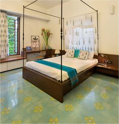 The artistic Butterfly Florette pattern in Blue Lagoon, Mint Green and Buttercup Yellow at a private Apartment gives a fresh, uplifting look to the room.  Photographer - Studio Kunal Bhatia