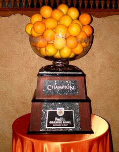 AND a snack! Now that's what we call dual-purpose. Sports Trophies, Football Awards, Orange Bowl, The Bling Ring, Championship Rings, Purpose, Snacks, Treats, Finger Food