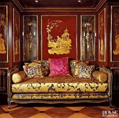 In the Chinese boudoir of a Parisian pied-a-terre, decorator Alidad regilded a pair of new sconces to make them appear more weathered and placed them above a custom-made daybed. #HouseandGarden