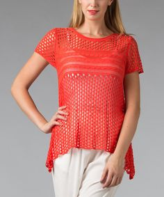 Beautiful and breezy, this sidetail knit top brings flowing fit and a pleasing pallet together for one whimsical warm-weather staple.