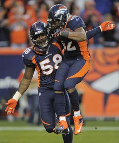 Chargers Broncos Football - Wesley Woodyard, Von Miller Denver Broncos outside linebacker Wesley Woodyard (52) celebrates with outside linebacker Von Miller (58) after recovering a fumble by San Diego Chargers quarterback Philip Rivers (17) in the third quarter of an NFL football game, Sunday, Nov. 18, 2012, in Denver. (AP Photo/Jack Dempsey)