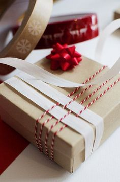 baker twine and paper weaving for gift wrapping
