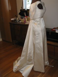 Vintage-inspired wedding gown with detachable train.  Bodice is fully beaded in seed pearls.