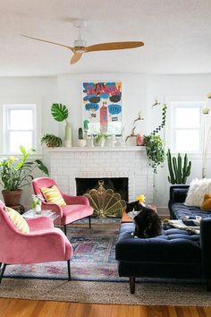 """Even when she's messy and ""occupado,"" this lively living room is lookin' lavish and lovely. Every element is usable, nothing's too presh, AND it tidies up right quick. That's exactly how we like it 'round here."" Photo by Jessica Brigham. Home decor Retro Living Rooms, Colourful Living Room, Living Room Designs, Living Room Decor, Modern Living, Quirky Living Room Ideas, Decorating Small Living Room, Living Room Vintage, Blue And Pink Living Room"