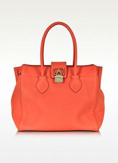 Roberto Cavalli Nuova Florence Coral Medium Handbag.  Nuova Florence Coral Medium Handbag by Cavalli is crafted in supple leather and is classically structured in honor of Florentine craftsmanship. Featuring double handles, twist lock snake embossed padlock closure, gold tone hardware and metal feet. Signature dust bag included. Made in Italy. http://www.eu.forzieri.com/handbags/roberto-cavalli/rc130114-014-00