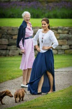 (L) Danish Queen Margarethe and Crown Princess Mary during their annual summer holidays photo session at Grasten Slot, Denmark, 25 July 2015.