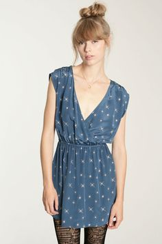 bangs, deep v hipster dress, tights, smoky eyes… :) simplicity at its finest