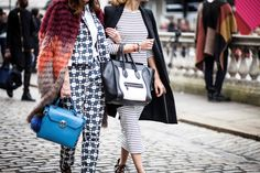 Anisa Sojka wearing black and white striped Finders Keepers fitted maxi dress, tailored black Zara long coat, black / white Céline handbag and black / white / red Zara sandal heels. Fashion blogger street style shot during London Fashion Week with Mariko Kuo of Silk and Suits by Cristiana Malcica.
