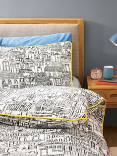 Monochrome print bedding with yellow piping is perfect for anyone who wants to subtly brighten up their bedroom in the summer.