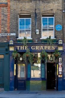 London. The Grapes - Narrow Street's famous pub that Charles Dickens himself used to visit. It even featured in one of his novels, 'Our Mutual Friend'. Now owned by local Limehouse resident Sir Ian McKellan, it's a very cosy pub famous for its fish restaurant with great views over the River Thames.
