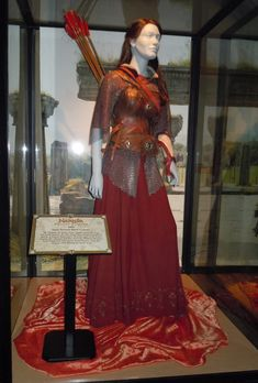Susan Pevensie battle costume (Prince Caspian; Narnia). Can't tell for sure, but based on the evidence of other costumes, I'd bet the design on the hem of the skirt is daffodils.