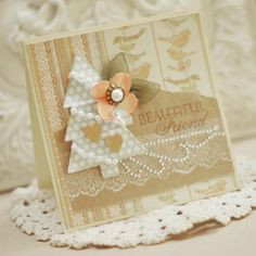 "The Nina-designed goodies I used on this card are Penny Black ""Lace Delight"" (lace stamp and sentiment) and Spellbinders ""Sweet Folk Art"" dies (tree and mini-heart die-cuts)."