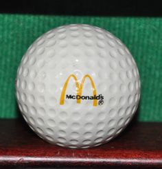 Vintage McDonald's Corporation Logo Golf Ball Ball is in very good condition with light evidence of play. The ball pictured is the ball for sale.