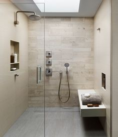 Locust Street Baths k YODER design  Natural limestone accent wall tile and satin nickel fixtures lend serenity and warmth to the master bath. The generous spa shower includes an integrated linear drain.