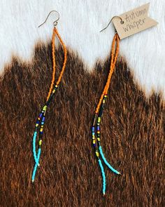 Autumn Whisper These long seed bead earrings are made with gold ear wire, beadalon thread and locally-sourced beads. I love this color combo with a mix of colors in between. This will go with any outfit.and the pop at the bottom adds so much flavor Seed Bead Jewelry, Boho Jewelry, Jewelry Crafts, Beaded Jewelry, Jewelry Ideas, Jewelry Findings, Jewellery Box, Fashion Jewelry, Seed Beads