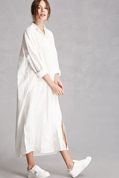 This longline cotton woven shirt dress features an oversized silhouette with dropped shoulders, a button-front placket, basic collar, chest patch pocket, long buttoned cuff sleeves, and a vented curved hem. This is an independent brand and not a Forever 21 branded item. (This item runs large, please size down.)