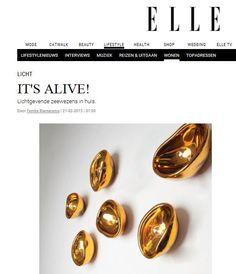 """""""It's alive! Lichtgevende zeewezens in huis. Ze doen denken aan schelpen en zeedieren, de lampen met de naam Zeewezens voor aan de muur. Aan gekleurd glas wordt zilver toegevoegd, en vervolgens wordt het in een organische vorm geblazen. Die combinatie zorgt voor een magnifiek spel van lichtreflecties."""" #lifestyle #interiordesign #lighting AUSUM DARK spotted at ELLE NL #magazine [WWW.ELLE.NL]"""