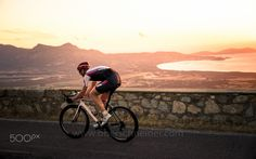 """Sunset Cycling #2 - Sunset race biking on the coast of the french island Corsica.  Image available for licensing.  Order prints of my images online, shipping worldwide via  <a href=""""http://www.pixopolitan.net/photographers/oberschneider-christoph-a6030.html"""">Pixopolitan</a> See more of my work here:  <a href=""""http://www.oberschneider.com"""">www.oberschneider.com</a>  Facebook: <a href=""""http://www.facebook.com/Christoph.Oberschneider.Photography"""">Christoph Oberschneider Photography</a> follow…"""