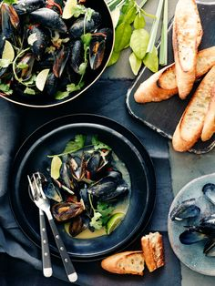 A simple recipe for Coconut Curry Mussels with green curry and served alongside grilled bread to soak up all the delicious cooking liquid!