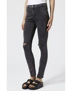 Black jeans are a must in every girl's wardrobe. We love the roughed up knees on this pair. #divinecaroline #distresseddenim #denim #blackjeans #skinnyjeans