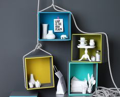 white objects, colour boxes (love the styling)  good idea for window decoration