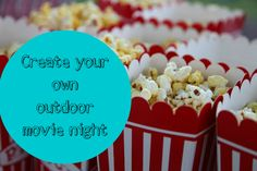 Creating Your Own Outdoor Movie Night {summer is coming} | Jeanne Oliver Food: Popcorn with extra real butter and lemonade and candies in boxes white lights/bunting decorations