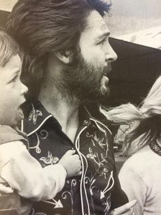 Paul McCartney, singer, songwriter and bass player for the recently disbanded Beatles, with his wife Linda (1941 - 1998) with their child, Mary (left) and Linda's child from a previous marriage, Heather. at Gatwick Airport,May 12, 1971 .