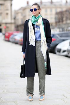 street style: Paris Fashion Week Fall 2014... Her menswear-style take got a jolt of color, thanks to those shades.