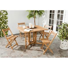 An ingenious space saver, Arvin outdoor dining table and chair set is designed for gracious outdoor living.
