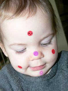 Sticker Fun--helping toddlers to identify parts of their faces and bodies using stickers