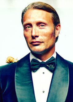 My favorite Mads Mikkelsen picture of all time. He has a PET SNAIL on his shoulder.