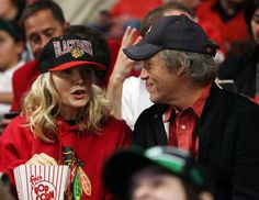 Michelle Pfeiffer Photos Photos - Michelle Pfeiffer and David E. Kelley attend Game Five of the Stanley Cup Final between the Chicago Blackhawks and the Boston Bruins at the United Center on June 22, 2013 in Chicago, Illinois. - 2013 NHL Stanley Cup Final - Game Five