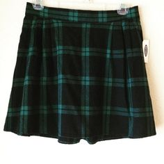 "Black/Green Plaid Skirt Super fun plaid skirt. Features teal green and black plaid pattern. Waistband is flat in the front and elastic in the back. Very comfy and cute! 100% cotton. Color truest in pic 2.  Measurements: 14"" waist (stretchy) 16"" length Condition: Brand new, never worn.  PayPal/Trades  Please ask any questions prior to purchasing. All sales final. Old Navy Skirts"