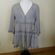 New Vintage or Boho Chic? Soft styling complimented by crochet lace, tonal embroidery and 4 little buttons to keep it all together.  Soft dove grey color goes with everything. V Cristina  Tops Tunics