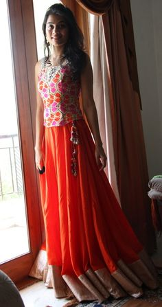 Orange lehenga with a floral corsette #lehenga #orange #floral #blouse #wedmegood