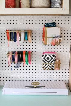When it comes to getting your craft room organized, it's all about the details. Take this pegboard for instance—it becomes the perfect way to store your ribbons or little office supplies. Plus, you can rearrange it anytime the inspiration hits you!
