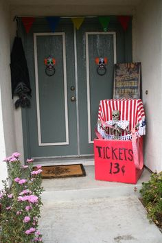 To show another couple of ideas from last year, I made my ticket booth out of two boxes to fit a 3-foot-tall skeleton I had. We don't have a lot of room on the front porch, so this worked out well, and was at eye level for most of the tot'ers too. Our fortune teller was at a table under a covered patio on the side of our condo. She is a 5-foot-tall Costco skelly.