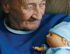 Alzheimer's...I once worked in a place that did not allow caregivers to give or let the residents have childrens toys(including dolls.)  I do not see this as degrading for the resident but as a wonderful way to pass the day, caring for someone they feel is in need.