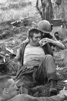 "dogatemytank: "" © Rick Merron 1965 US soldier with a wounded trooper of the 1st Cavalry Division, la Drang, Vietnam """
