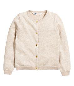 Light pink melange. Fine-knit cardigan in soft cotton. Round neckline, buttons at front, and short slits at sides. Slightly longer at back.